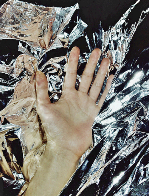 Hand on anti-static foil