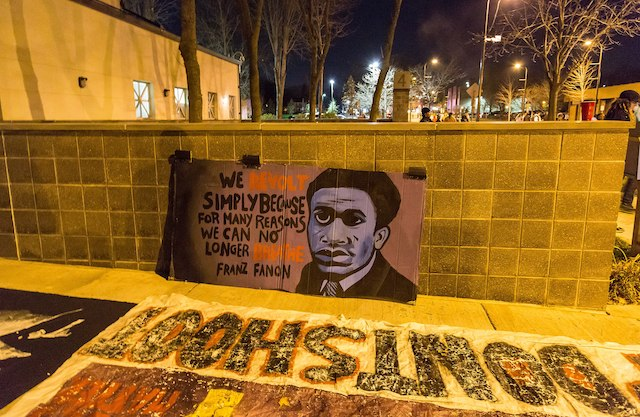 """We revolt simply because for many reasons we can no longer breathe."" Fanon Banner outside the Minneapolis Police Department following shooting of Jamar Clark on November 2015. Photo: Tony Webster"