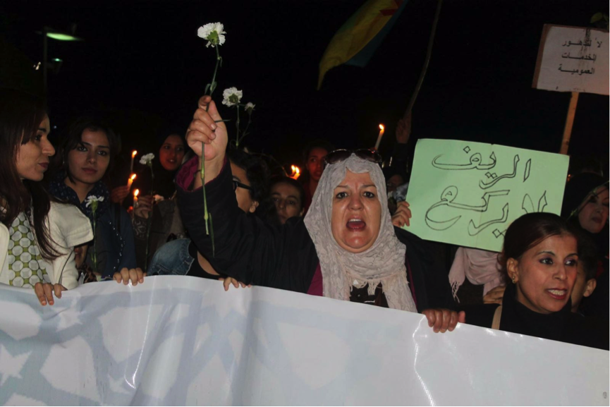 Moroccan women with placard 'The Rif Does Not Kneel'
