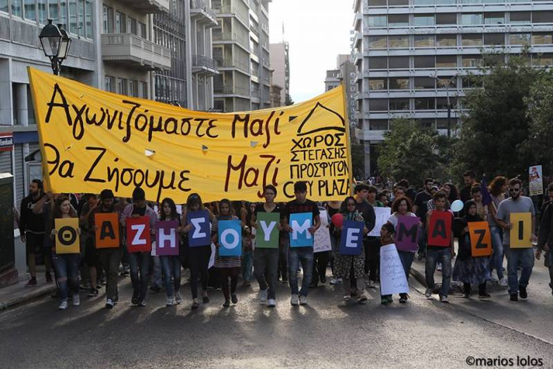 'we struggle together - we live together' rally in Athens by Marios Lolos