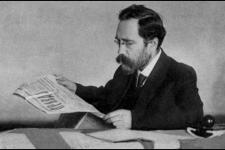 Lev Kamenev reading Pravda